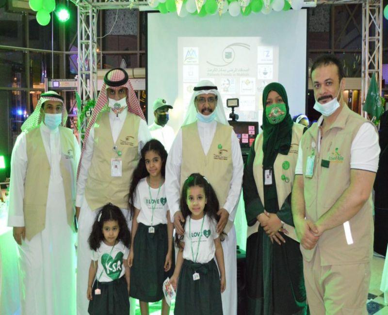 لجنة أصدقاء المرضى بصحة مكة تحتفل باليوم الوطني السعودي91 بسوق الحجاز بمكة